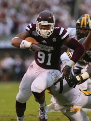 Former Mississippi State player Preston Smith is pictured here in a game against Southern Miss in 2014.
