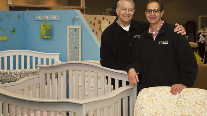 Bob Simon and his son, Mark, inside Simon's Baby Furniture in Pittsford.