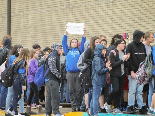 """Students from Simon Kenton High School walked out and marched around the school for 17 minutes for the 17 victims in the recent Florida school shooting. They shouted, """"Never again"""" as they marched on Wednesday Feb. 21, 2018."""
