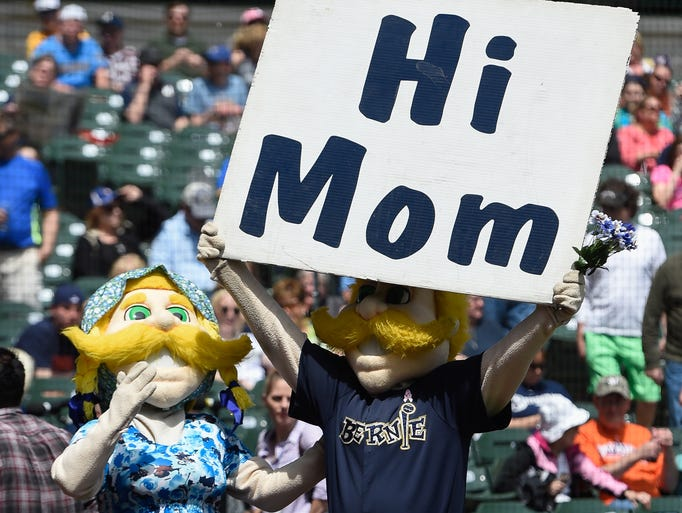 Milwaukee Brewer mascot, Bernie Brewer, holds a sign prior to the game against the New York Yankees at Miller Park on May 11, 2014.