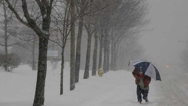 A man walks on Joseph Avenue in Rochester during the first heavy snow of the 2003-04 season.