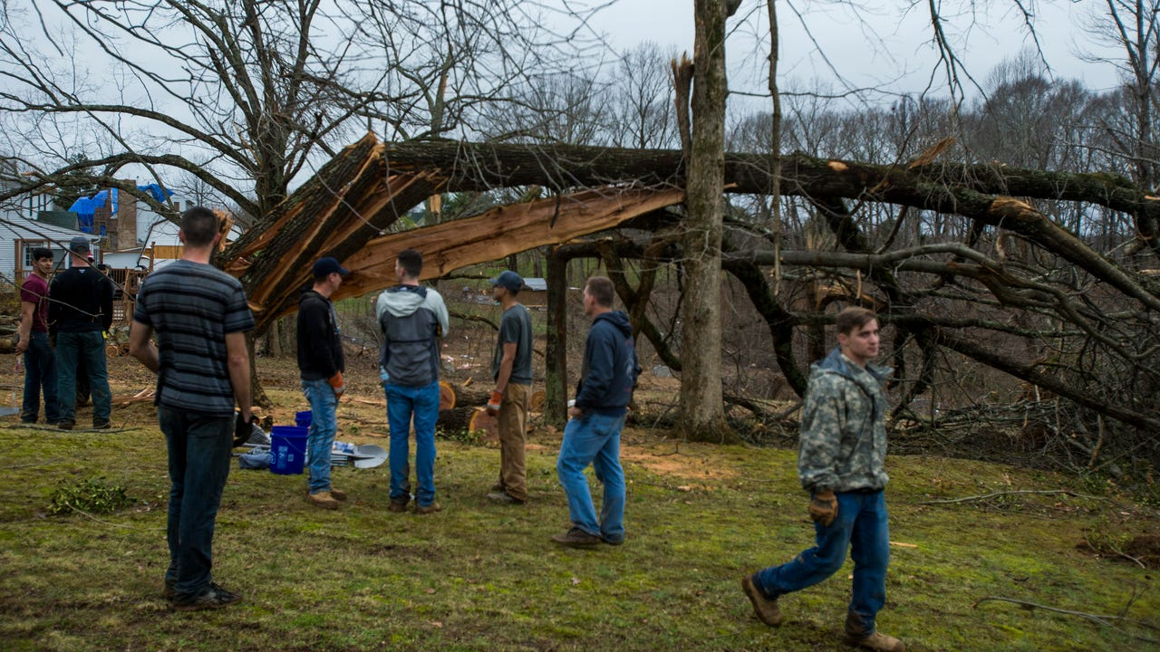 112 Fort Campbell soldiers from Viper Company, 1-26 Infantry, Strike Brigade, 101st Airborne Division, helped Wednesday in Deepwood Estates to cut up fallen trees, clear trash and help people move.