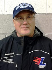 Coach Ron Predmesky's Ladywood hockey team is off to