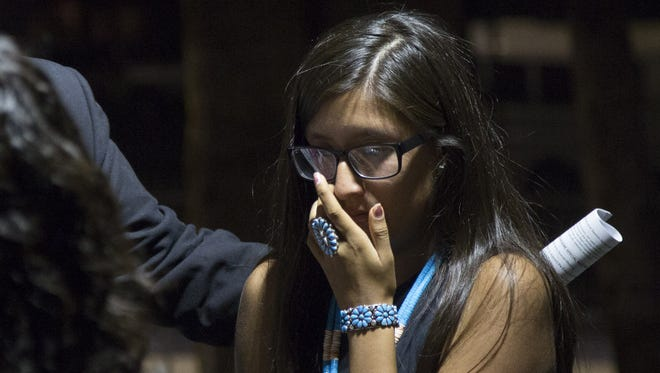 Nichole Segay wipes tears from her eyes after telling her story during the Phoenix Union High School District Governing Board meeting in Phoenix on Nov. 2, 2017.