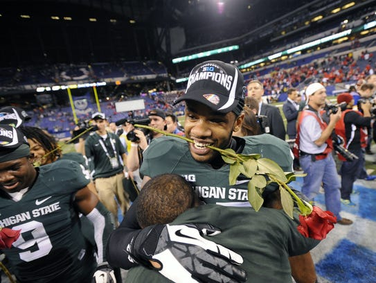 MSU's  Kurtis Drummond gets hugs as he celebrates with