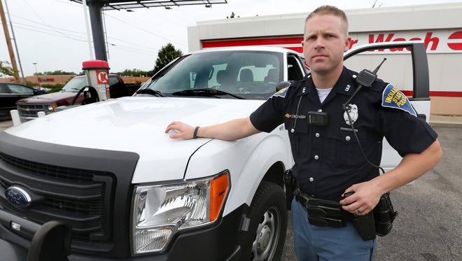 Indiana State Police Trooper Andrew Forgey, shown on Friday, Aug. 29, 2014, was assigned that day to patrol I-65 on Indianapolis' Southside. Forgey patrols road-construction zones in an unmarked Ford F-150 pickup truck owned by the Indiana Department of Transportation that looks like a construction worker's truck.