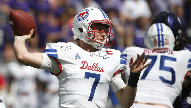 "SMU quarterback Shane Buechele (7) throws against TCU during the first half last season. Buechele will lead the Mustangs against Texas State on Saturday at 3:30 p.m. Bobcats coach Jake Spavital says, ""The kid understands how to attack defenses and he knows how to get the ball out of his hand."""