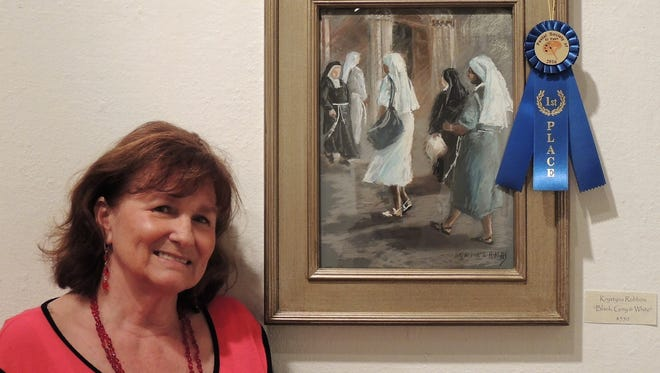"""Krystyna Robbins with her first-place pastel, """"Black, Gray & White."""""""