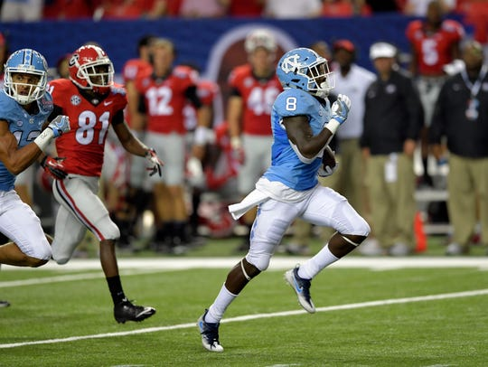 North Carolina running back T.J. Logan (8) returns