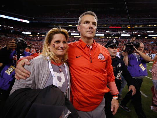 Ohio State coach Urban Meyer, right, and his wife,