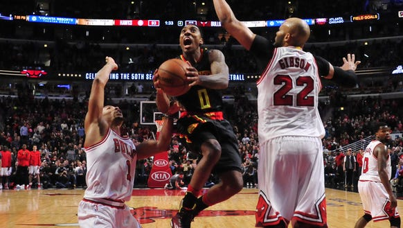 Atlanta Hawks guard Jeff Teague (0) goes to the basket