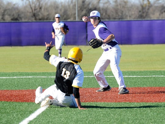 Wylie shortstop Gatlin Martin (21) throws to first after getting a force out at second during the Bulldogs' 15-5, six-inning win against Snyder at Bulldog Field on Tuesday, March 20, 2018.