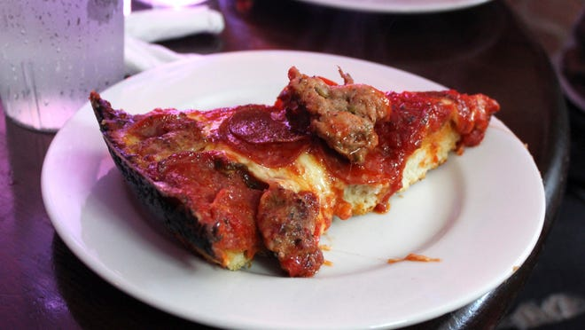A slice of deep-dish pizza is shown at Pequod's in Chicago.