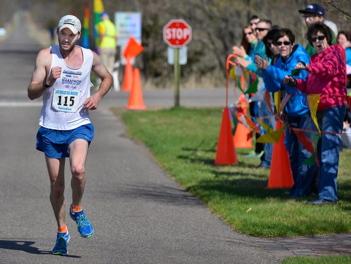 Justin Gillette, 31, of Goshen, Ind., heads for the finish line and a first overall finish of 2:42:59 in the Lake Wobegon Trail Marathon Saturday morning in Avon.
