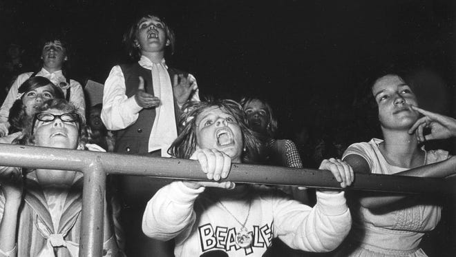 Beatles fans - about 12,000 of them - cheer the Fab Four at the Milwaukee Arena on Sept. 4, 1964.