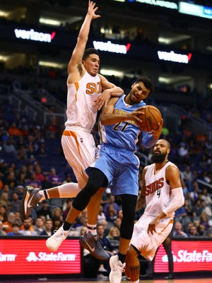Nov 27, 2016: Denver Nuggets guard Jamal Murray (27) drives to the basket against Phoenix Suns guard Devin Booker in the second half at Talking Stick Resort Arena. The Nuggets defeated the Suns 118-114.