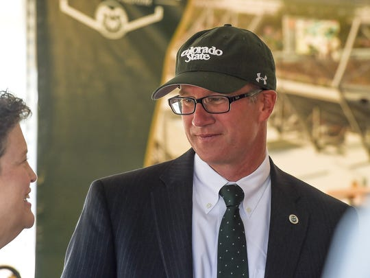 Colorado State University's Athletic Director Joe Parker speaks with people before a groundbreaking ceremony for the new CSU football stadium Saturday, Sept. 12, 2015, in Fort Collins.