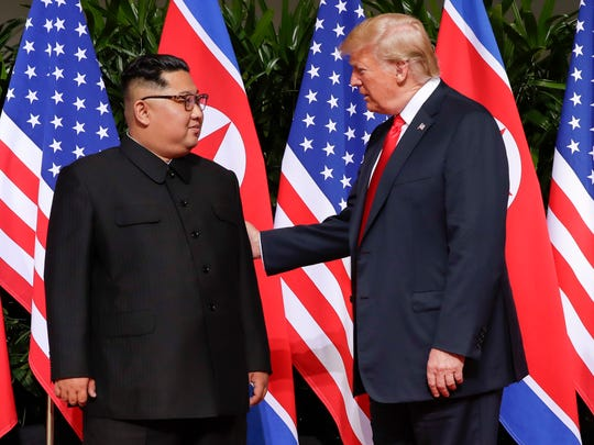 U.S. President Donald Trump greets North Korean leader Kim Jong Un at the Capella resort on Sentosa Island on Tuesday, June 12, 2018, in Singapore.
