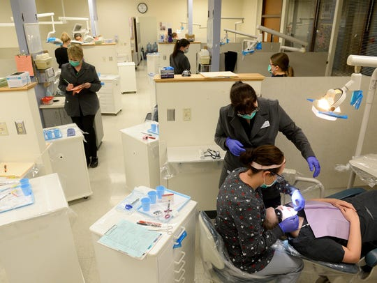 Great Falls College-MSU dental hygiene students practice in this file photo.