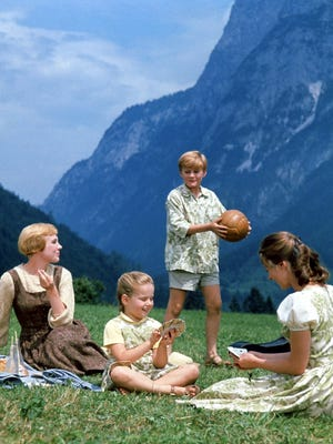 """This photo provided by Twentieth Century Fox Home Entertainment shows, from left, Julie Andrews, as Maria, Kym Karath, as Gretl, Duane Chase, as Kurt, and Chairmian Carr, as Liesl, in a scene during the song, """"Do-Re-Mi"""" from the film, """"The Sound of Music."""""""