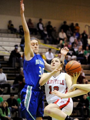 Penfield's Margot Hetzke, right, shoots against Cicero-North Syracuse's Breanna Stewart in the 2012 state title game. Stewart, now a star for UConn, and C-NS won, 62-48.