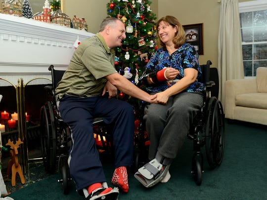 Steve and Sallie Whelan sit in their wheelchairs at
