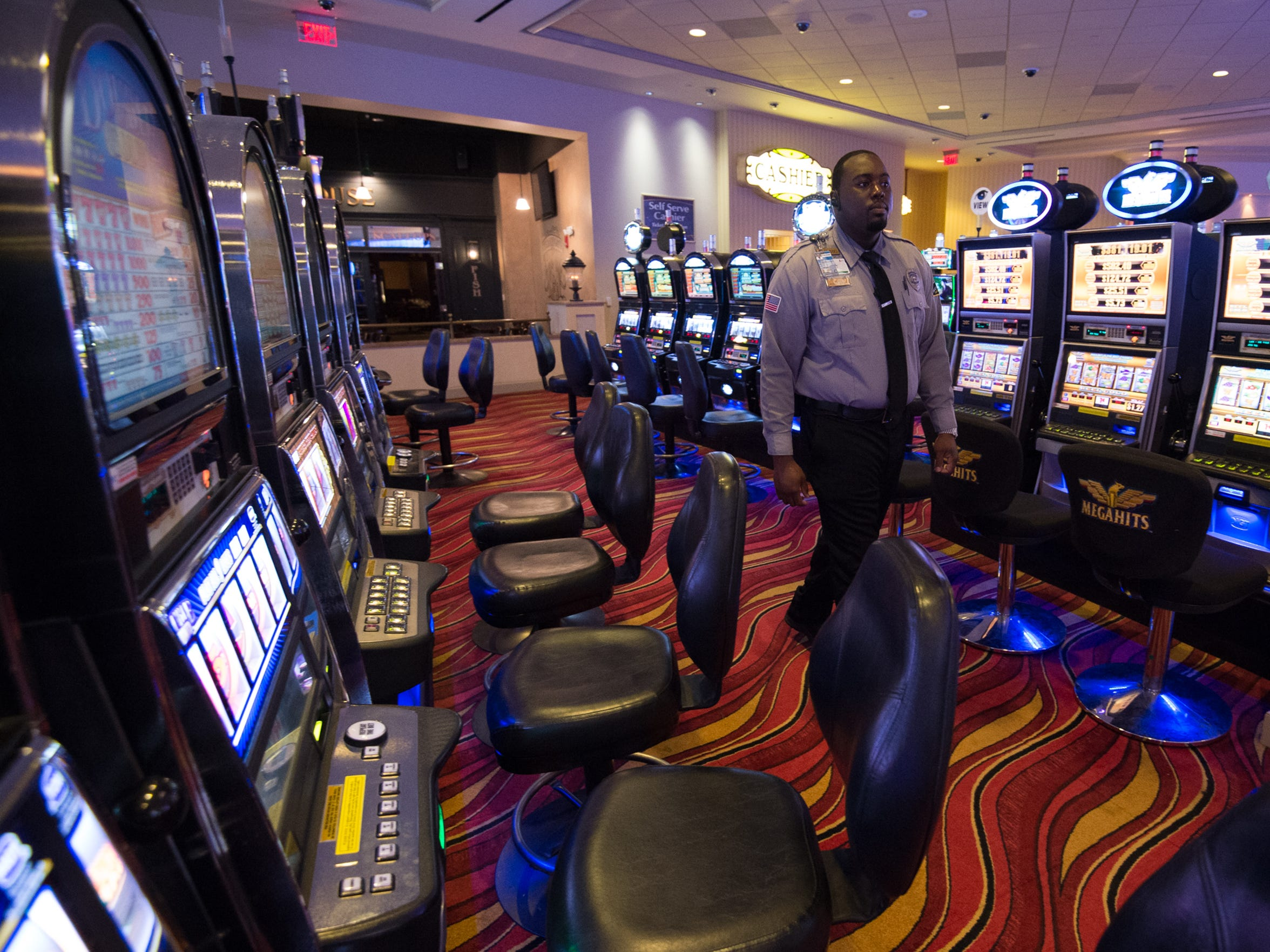 A security officer patrols Dover Downs Hotel & Casino in Dover on May 27. Salman Choudhary is accused of funneling ill-gotten cash through the casino.