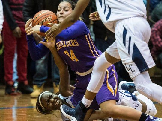 Lebanon Catholic's Neesha Pierre and Lancaster Catholic's Corina Rivera fight for a loose ball.