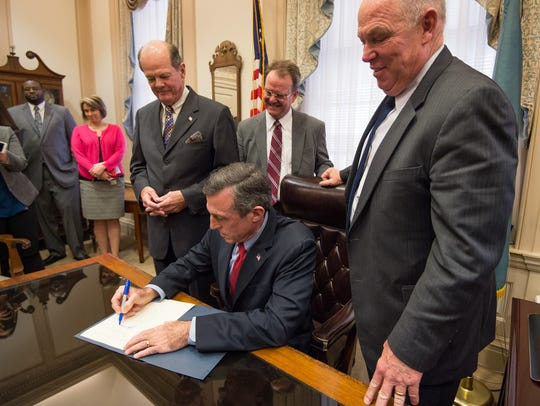 Gov. John Carney signs his first executive order in