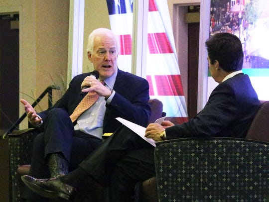 U.S. Senator John Cornyn, left, talks about NAFTA,