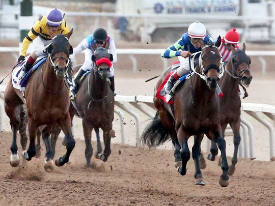 Runaway Ghost, right foreground, with jockey Tracy J. Hebert at the helm, steams to the finish line and first place in the 15th running of the Sunland Derby on Sunday at Sunland Park Racetrack & Casino.