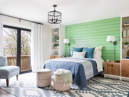 The DIY Networks remodel of this Colchester home's master bedroom got rid of wood-paneling and added glass doors on the lake-facing side of the home.