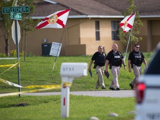The Port St. Lucie Police Department investigates the scene of a murder-suicide Wednesday, March 7, 2018, after a confrontation between the drivers of two vehicles near the intersection of Savona Boulevard and Fletcher Lane in Port St. Lucie.