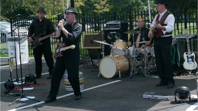 Chuck Hixon, second from left, performs with his band Vintage.