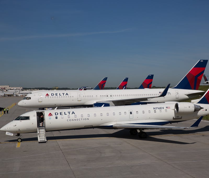 Several Delta Air Lines jets rest outside a hangar at the company's Atlanta hub on April 29, 2016.