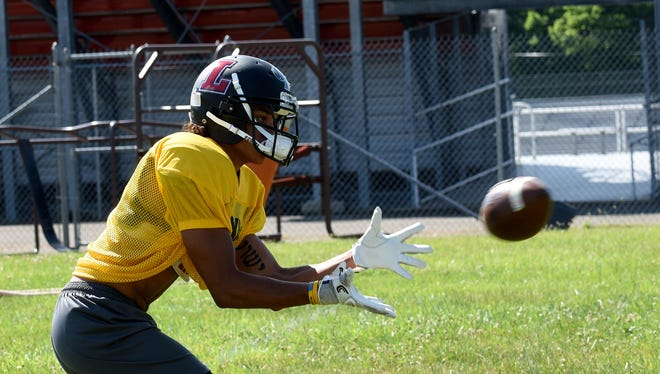 Watkins Memorial's Dante Fair catches a pass Monday during Licking County All-Star practice.