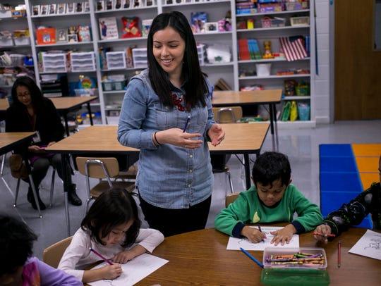 Claudia Quezada smiles as she checks the progress of