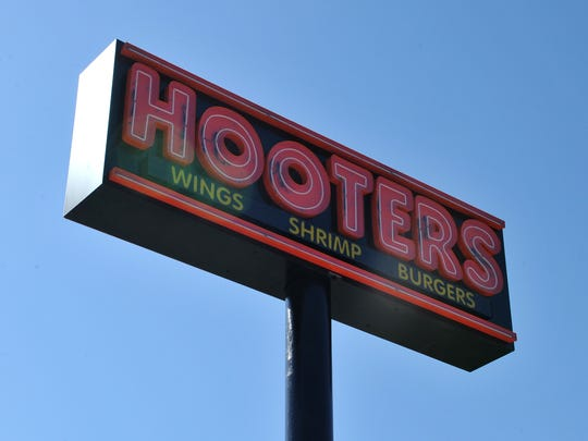 A recently placed sign outside the old Logan's Roadhouse advertises the building's soon-to-be new tenants, Hooters.