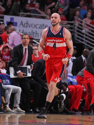 Washington Wizards center Marcin Gortat (4) celebrates scoring during the second half of game one of the first round of the 2014 NBA Playoffs against the Chicago Bulls at the United Center. Washington won 102-93.