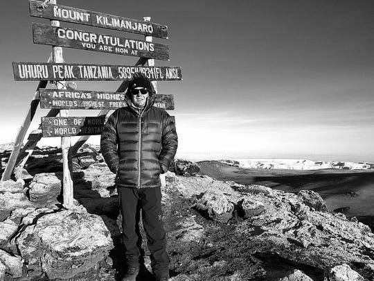 Jeremy Rogers atop Mount Kilimanjaro in Tanzania in 2016.