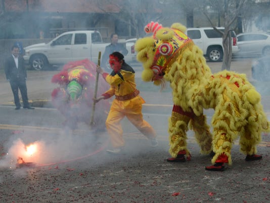 "ANI Vietnamese New Year Members of the local Vietnamese community celebrate the Vietnamese New Year, or Tet, at City Hall in downtown Alexandria Sunday, Feb. 22, 2015. Vinh Co (center) dresses as a monkey and said it represents ""cheering and enjoyment"" for"