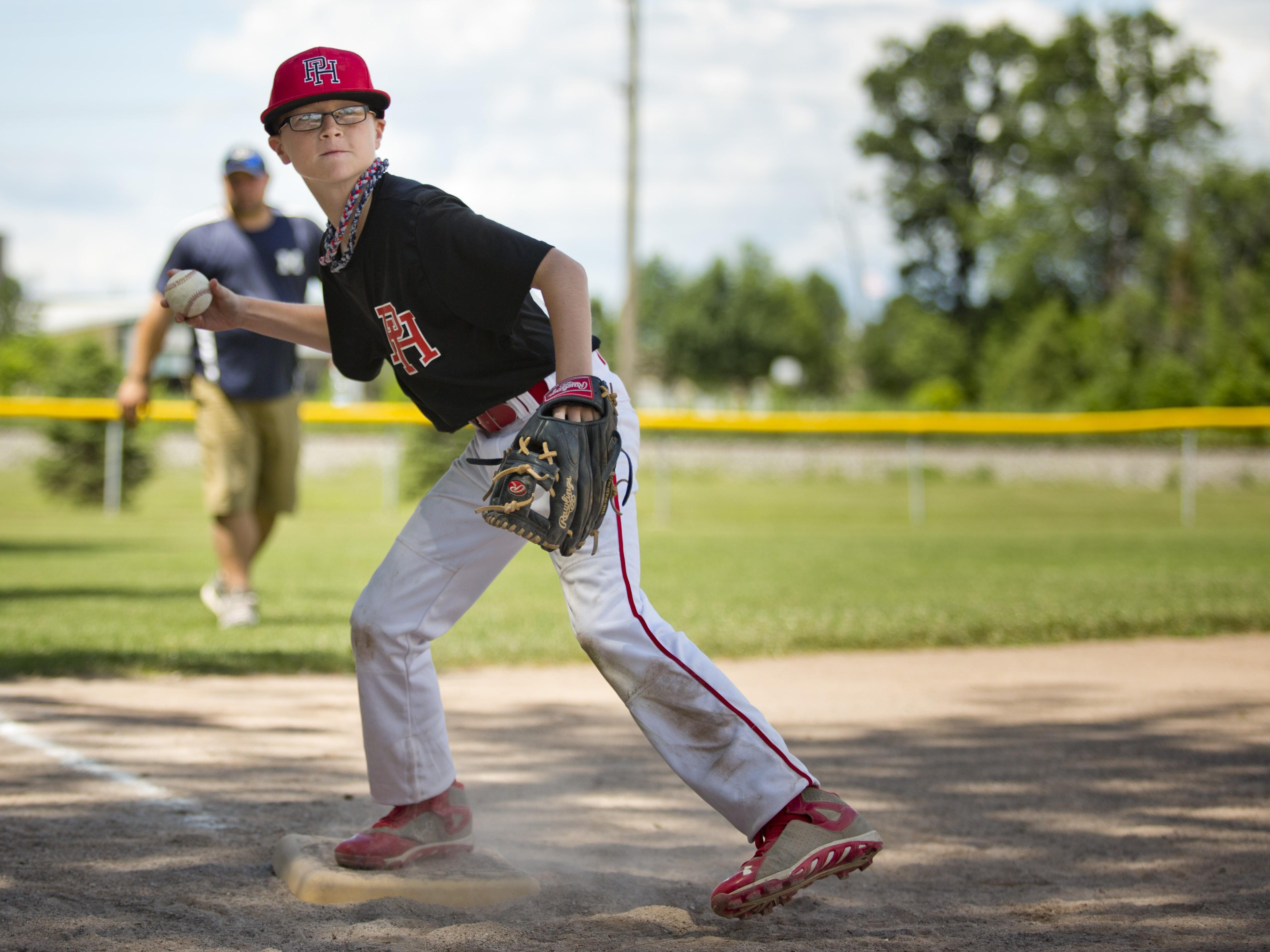 Brayden Albers, 10, throws the ball to home while competing in throwing with his Port Huron teammates during a Little League skills competition Saturday, August 1, 2015 at Marysville City Park.