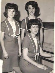 Linda Robinson  (Sholar), seated at the piano;  Rita