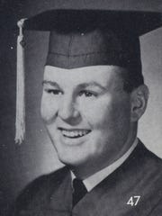 A file photo of a young Geno Martini wearing a graduation cap and gown.