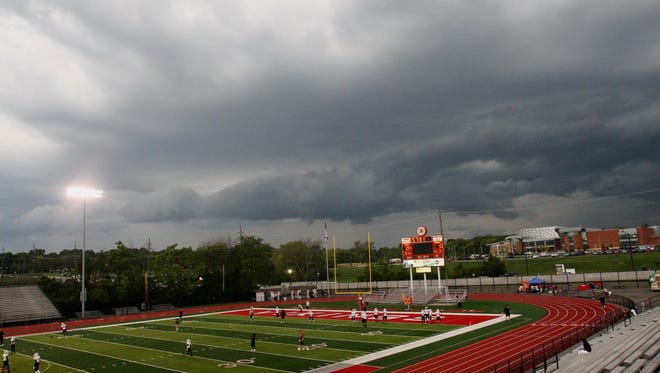 A storm rolls in over Princeton's Mancuso Field before Colerain visited the Vikings on Sept. 16.