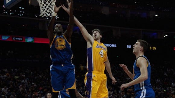 Dewayne Dedmon (21) of the Golden State Warriors rebounds against Ryan Kelly (4)  of the Los Angeles Lakers in the NBA match between the Los Angeles Lakers and the Golden State Warriors on October 18, 2013 in Shanghai, China.