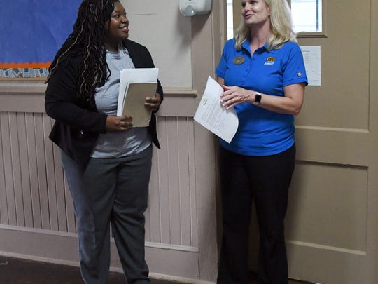 Collins Elementary music teacher Ashley Henry, left, speaks with Best Buy General Manager Laura McGlocklin about her submitting a winning tweet to Best Buy, winning $25,000 in Hewlitt Packard Educational Technology, including keyboards, headphones, music software, professional development support and more, for the music classroom.