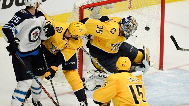 A shot by Jets center Paul Stastny (25) gets past Predators goaltender Pekka Rinne (35) in the first period of Game 7 on Thursday.