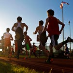 Action from the 1600 meter run Thursday evening at the Jeffersonville Track and Field Sectional at Jeff High School. By Matt Stone, The C-J May 21, 2015