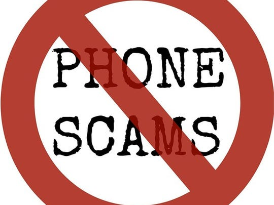 """the words """"phone scams"""" with a line drawn through them"""